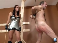 Sadistic Bitch: When Megan has had her fill she cuts the slut down and puts him back into his cage.