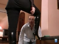 Hubby Licks Boots: She loves watching his eyes close with fear. It makes her feel even more powerful to control him like that.
